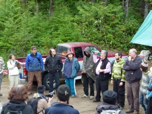 First Nation elders Xwu'p'a'lich (Barb Higgins) and Mus-swiya (Jamie Dickson) welcome everyone and speak with reverence and of the need to protect this forest, that lies on their shíshálh people's tradition lands,  for all of the community